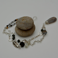 Sterling silver and grey and white gemstone necklace.