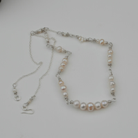 Creamy white freshwater pearl necklace with sterling silver.