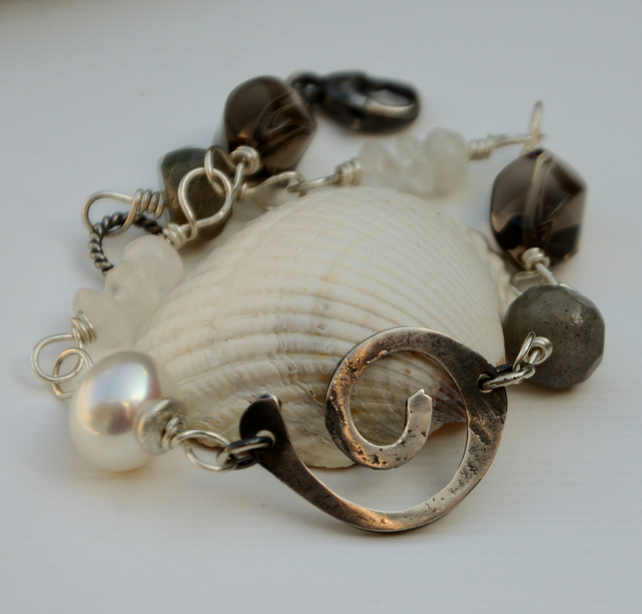 grey and white bracelet with handmade sterling silver spiral.