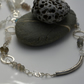 Grey and white gemstone necklace with silver.