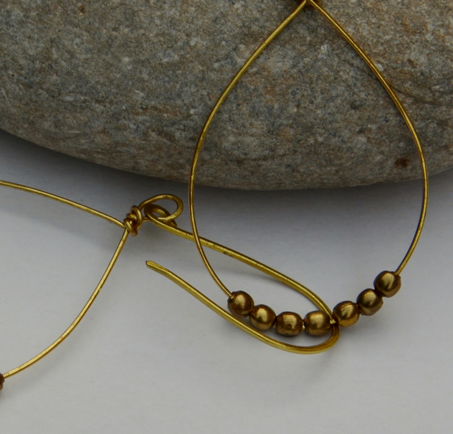 Hammered brass hoop earrings.