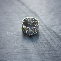Sterling Silver Ring with Drilled Pattern and Peridot and Topaz Gems