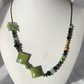 Green gold and black beaded flower necklace
