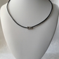 Black leather necklace, with cubic zirconia platinum coloured bead unisex