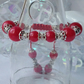 Pomegranate red macrame bracelet, with sterling silver bell charm.
