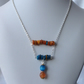 Orange and blue shell necklace.