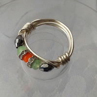 Ring in green Orange and silver, wire wrapped.