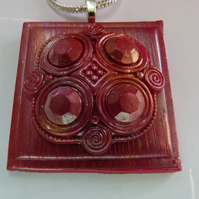 Pink,and gold highlighted  polymer clay Celtic style pendant