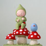 Sweet little Folk art pixie sculpture on toadstool