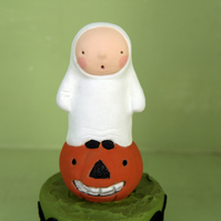Primitive folk art Halloween ghost figure on a pumpkin. Little box for tiny gift