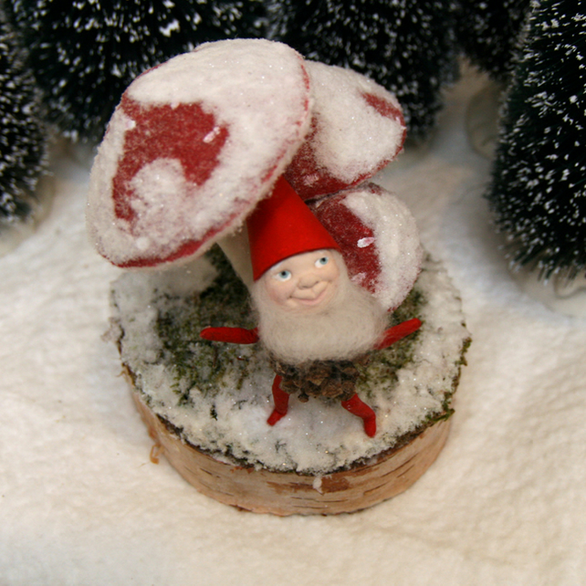 Folk art Christmas pixie sitting on snow covered toadstool