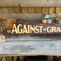 'GO AGAINST THE GRAIN' hand-painted vintage saw