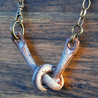Rustic Ceramic Knot Pendant with Copper Patina Glaze on Bronze Chain