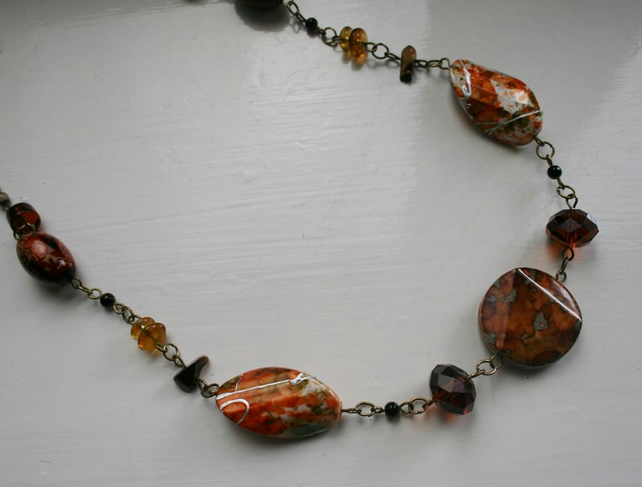 Necklace with brown and burnt amber beads