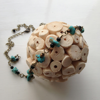 Necklace featuring magnesite turquoise nuggets