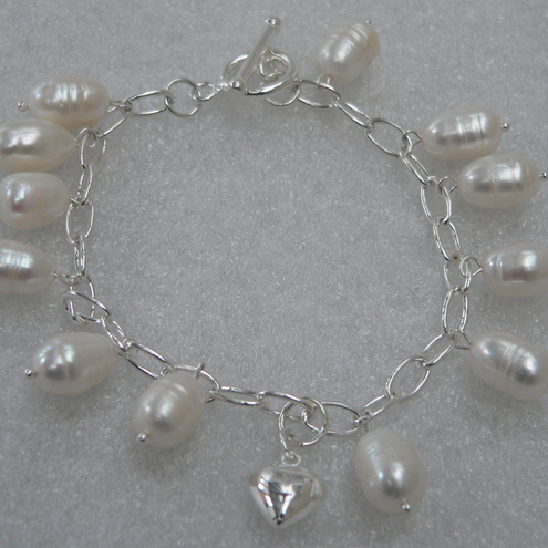 White Pearl and Sterling Silver Charm Bracelet