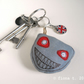 freehand embroidered zombie head bag charm