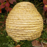 Medieval Bee-skep (classical British shaped straw Bee hive), bees, garden, hive