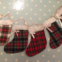 christmas tartan  stocking garland in christmas fabrics and fur trim with twine