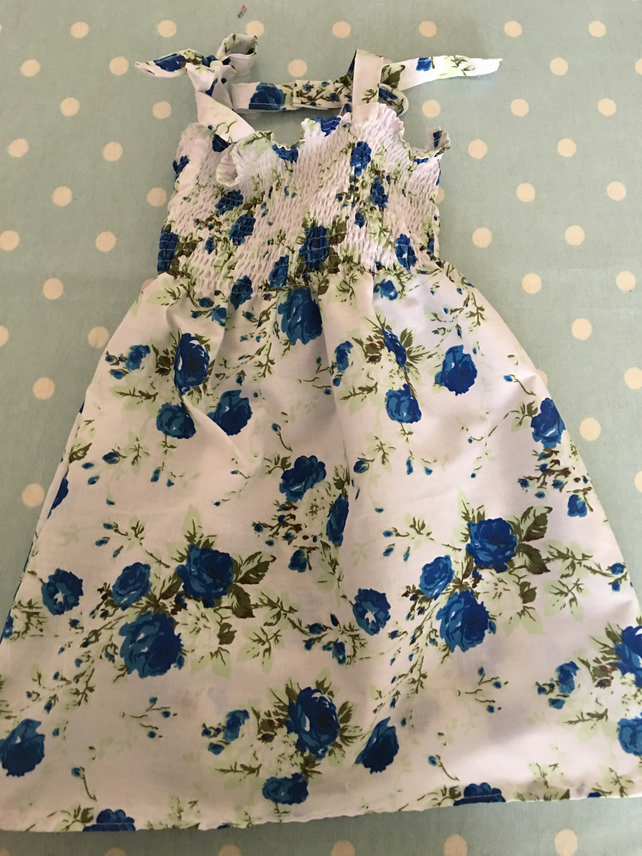 Aged 2-4 Smock style summer dress in  blue floral design cotton fabric