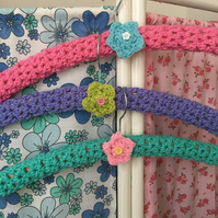 3 crochet covered hangers with crochet flowers
