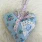 Large blue floral  fabric hanging heart with  ribbon and  lace