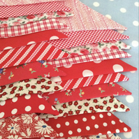 Shades of red  bunting in Cotton fabrics