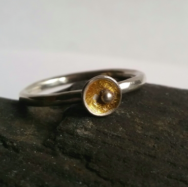 Silver ring with little gold cup