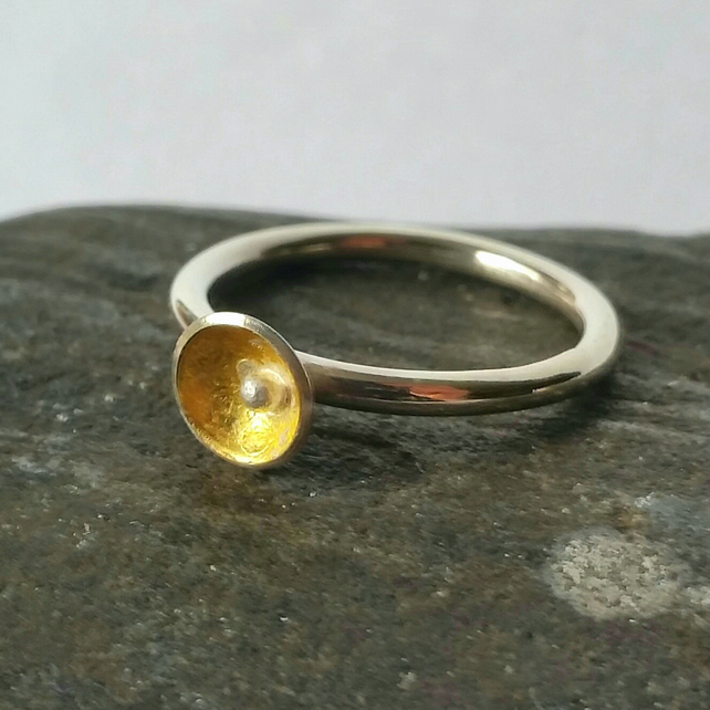 minimal sterling silver stacking ring with little gold cup and silver ball