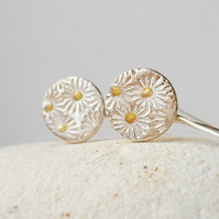 Silver round Drop Earrings with flower texture .