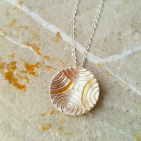 Silver swirl pendant with gold accent UK handmade