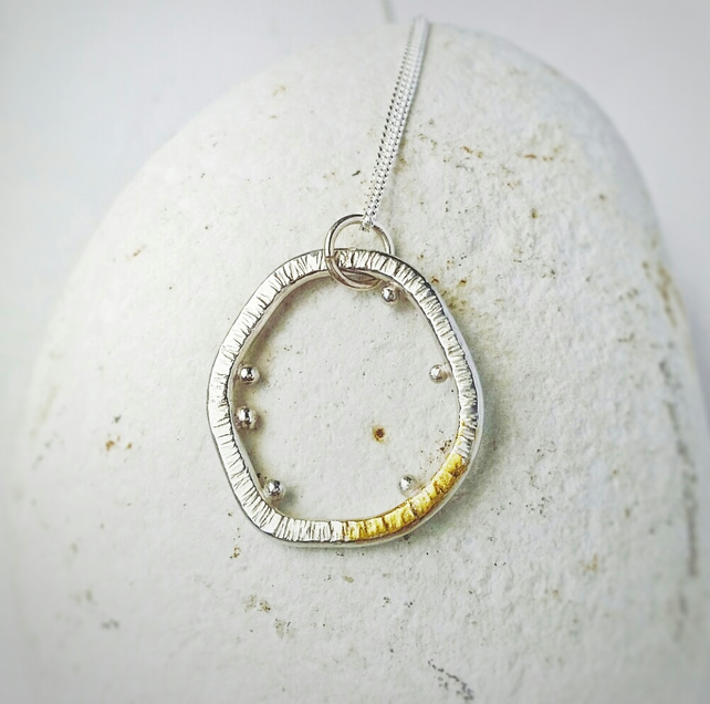 A pretty sterling silver necklace inspired by Lichen with a gold ascent