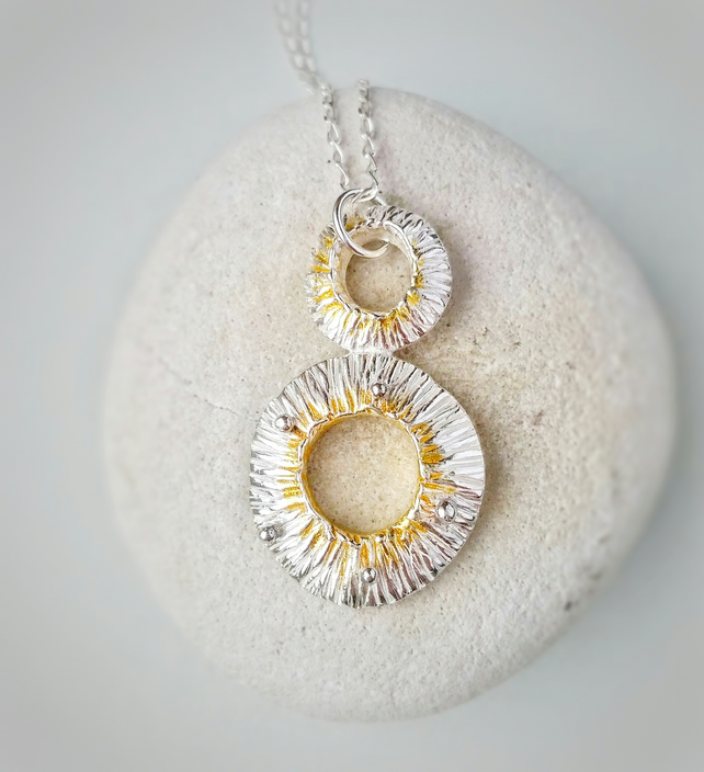 A quirky silver lichen inspired pendant necklace with 24ct gold