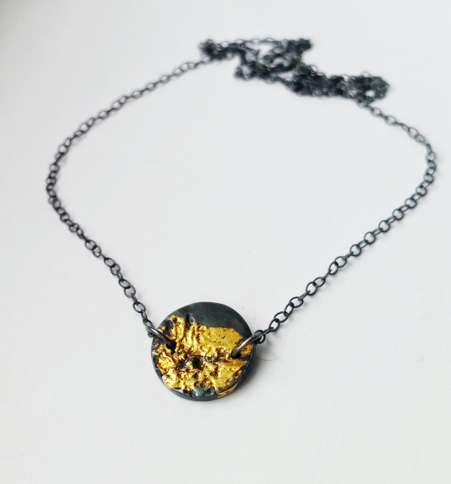 Unusual black and gold silver nature inspired necklace