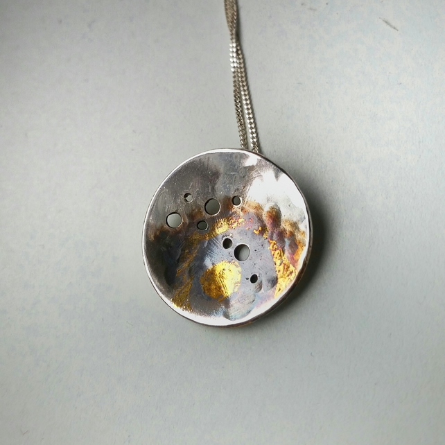 Unusual silver nature inspired necklace with gold