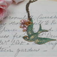 Vintage Style Swooping Patina Bird Necklace......