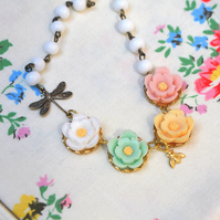 Pretty Floral Cabochon on glass bead chain....