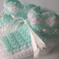 A Pair of Mint Green and White Crochet Baby Bootees