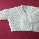 VINTAGE HAND KNITTED LITTLE BABY CROSS OVER CARDIGAN (ref A 748)