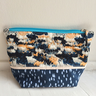 Medium sized blue cotton toiletries bag