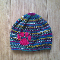 Hand knitted bright multi coloured paw print beanie hat