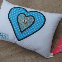 Pale Blue Cushion with appliquéd Heart