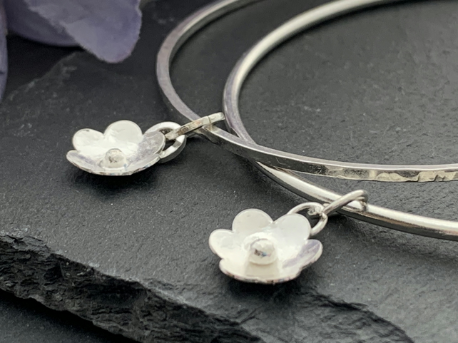 Sterling silver flower charm bangle