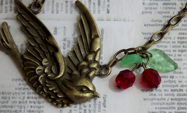 Vintage look bronze Swooping Swallow, with beaded charms