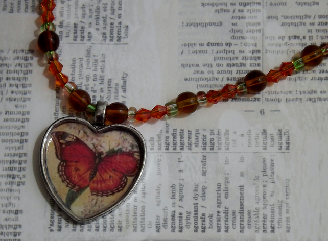 Tortoiseshell Butterfly, silver pendant on beaded necklace