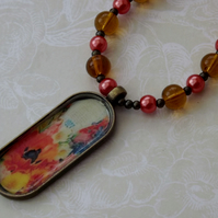 Poppy, pearls and glass, with poppy vintage inspired  image pendant