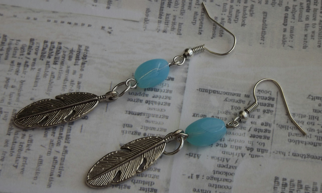 Silver Feather dangle earrings with blue beads.
