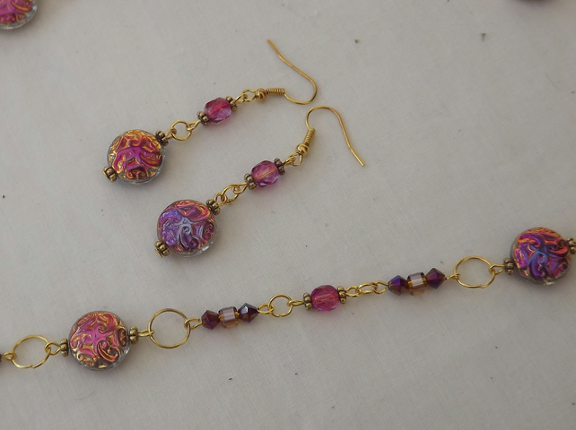 Persian Jewel, gold plated chain with lusturous glass beads