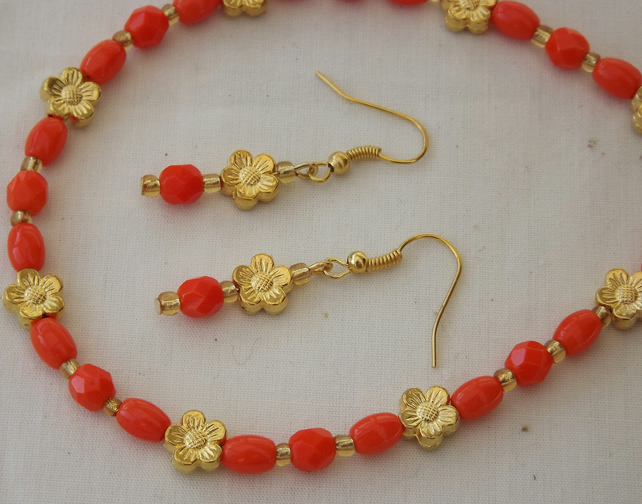 Satsuma, vibrant orange beads with Gold plated metal daisies