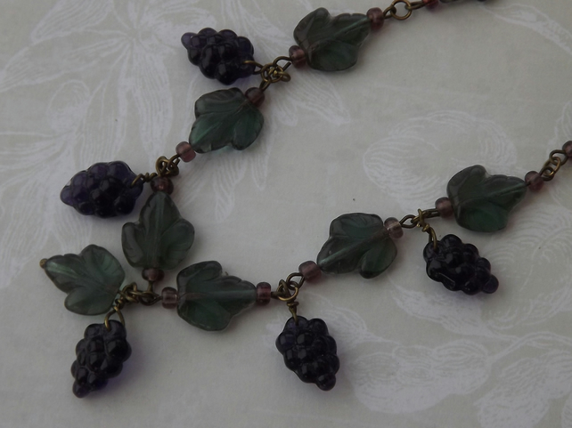 Bacchus, glass grapes and vine leaves beaded necklace